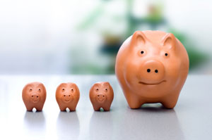 Compound interest concept - three piggy banks - photo