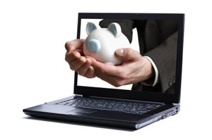 Internet-only banking - laptop screen with piggy b - photo