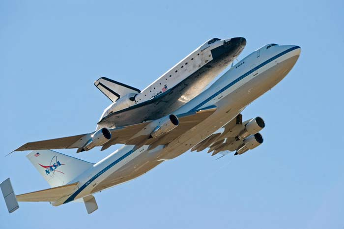 Shuttle being carried by 747 aircraft
