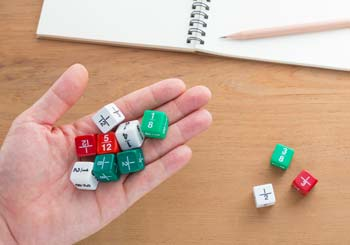 Dice with fractions being held in hand