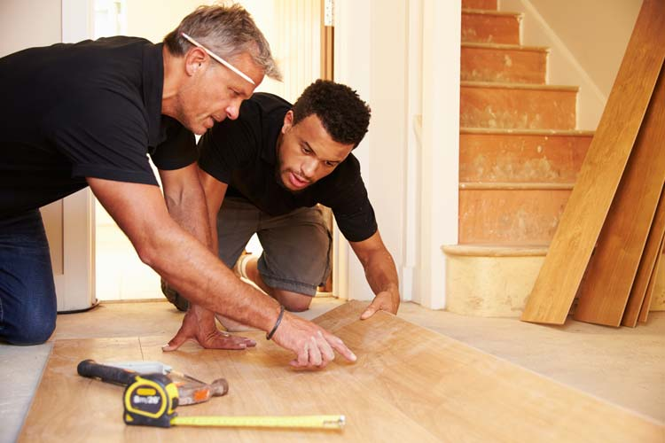 Two Men Measuring Laminate Floor