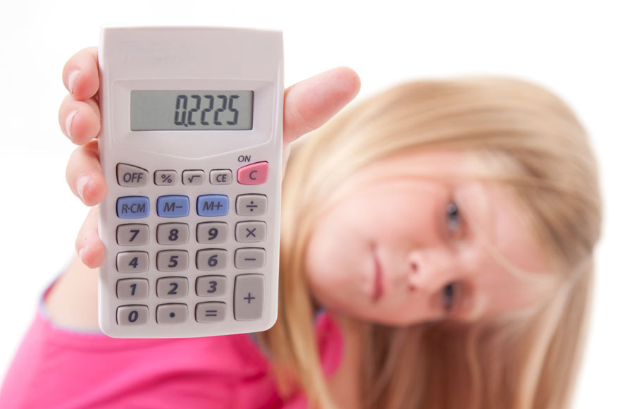 Girl holding calculator with decimal displayed on it