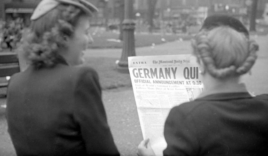 The front page of The Montreal Daily Star. The article announces the German surrender and the impending end of the World War II