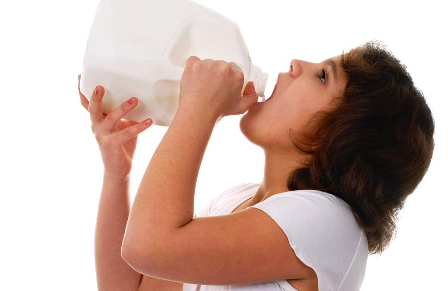 A person guzzling milk