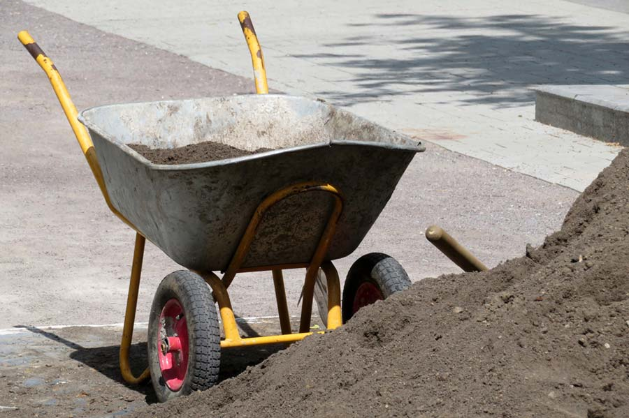 Wheel barrow measuring out the cubic yards of soil
