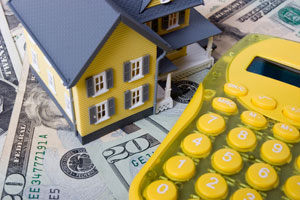 Mortgage refinancing - house, calculator and dollar note