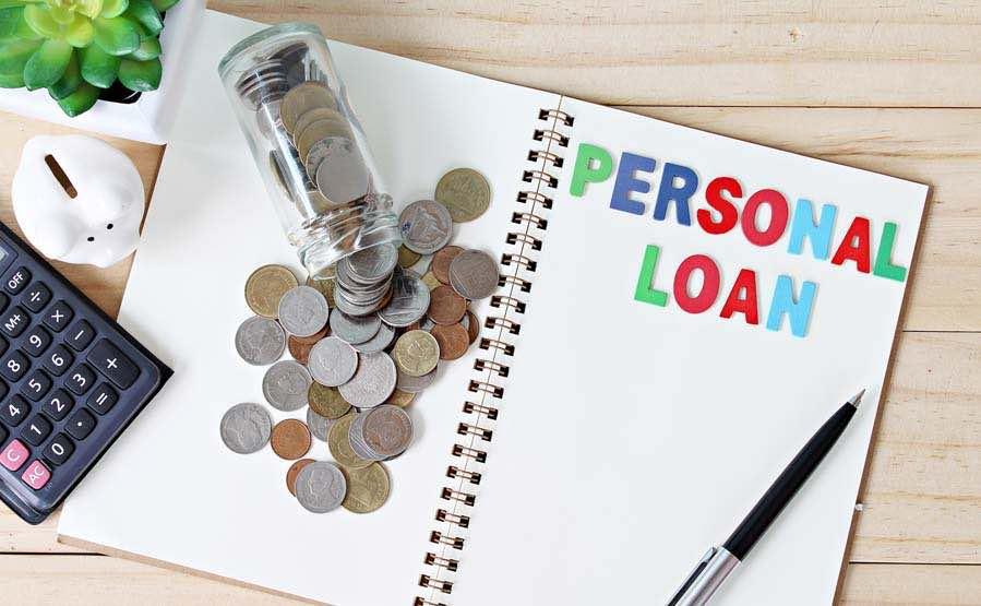 Personal loan on paper with calculator