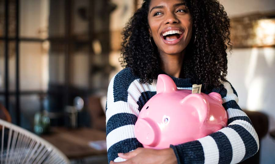 Woman holding piggybank for saving her pay